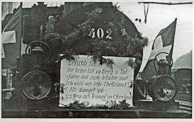 Lok 402 mit Spruch Letschti Fahrt